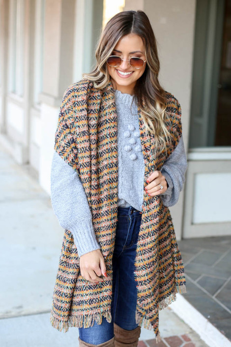 Model wearing the Plaid Fringe Blanket Scarf in Navy from Dress Up  with sweater Front View