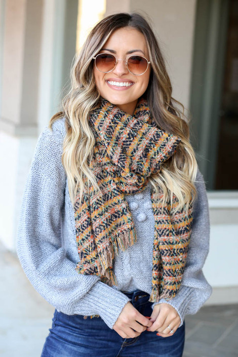 Navy Plaid Fringe Blanket Scarf on Model with sweater and jeans Front View