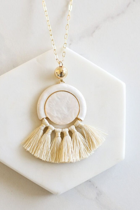 Ivory - Statement Tassel Necklace Flat Lay on marble hexagon
