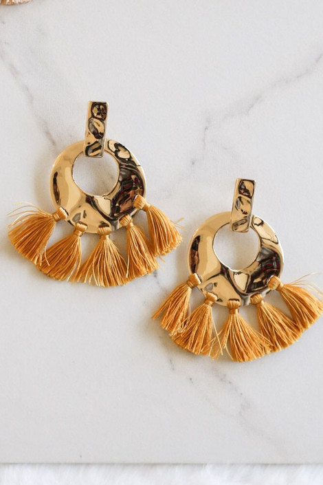 Mustard - Hammered Gold and Tassel Statement Earrings Flay Lay on Marble