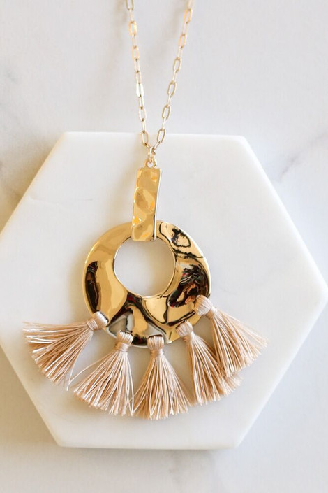 Taupe - Hammered Gold and Tassel Statement Necklace flat lay on hexagon