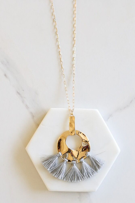 Grey - Hammered Gold and Tassel Statement Necklace flat lay