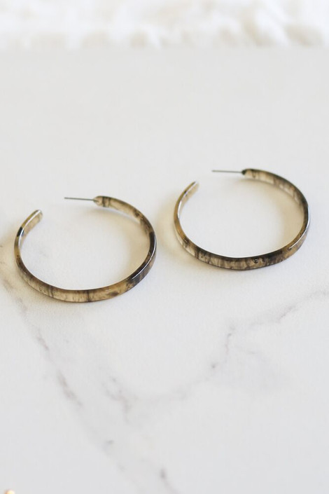 Olive - Skinny Tortoise Hoops from Dress Up flat lay