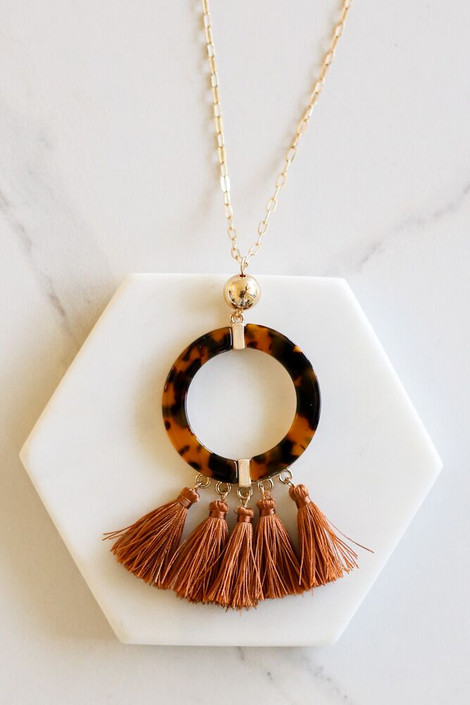 Rust - Tortoise and Tassel Statement Necklace Flat Lay on Marble Hexagon