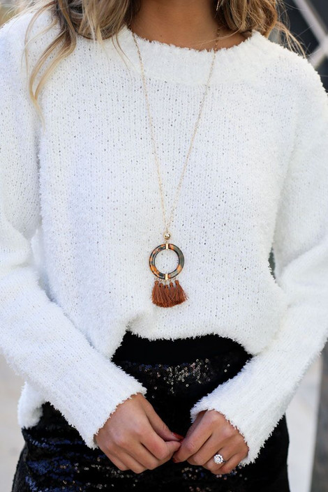 Rust - Tortoise and Tassel Statement Necklace on Model with Ivory Sweater