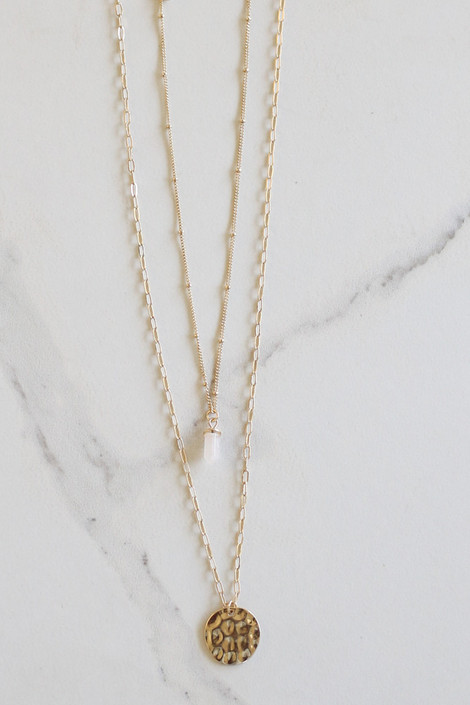 Gold - Stone and Disk Layered Necklace flat lay on marble background