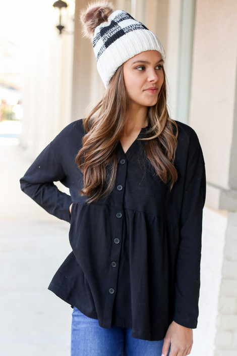 Model from Dress Up Boutique wearing the Button Down Babydoll Top in Black Front View
