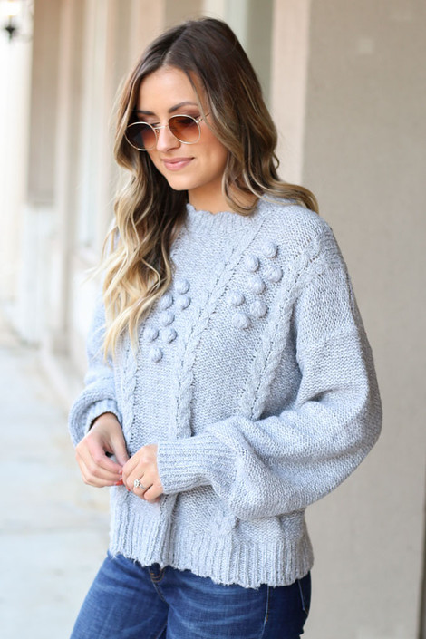 Model from Dress Up wearing the Cable Knit Pom Pom Sweater Side View