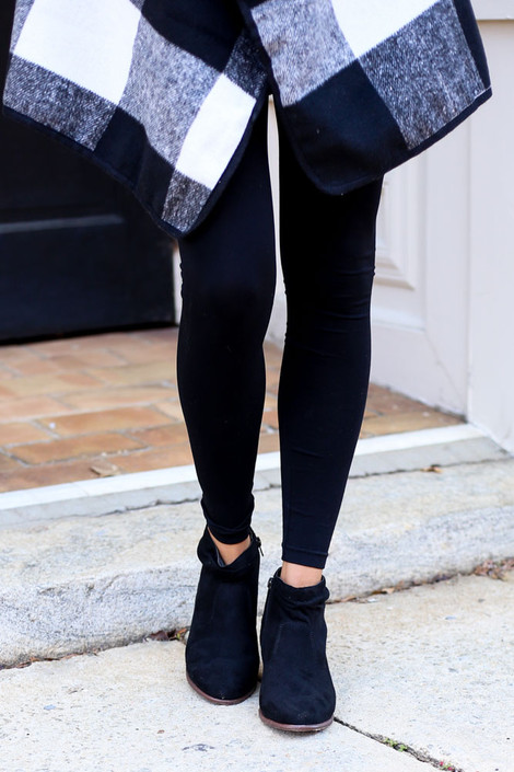 Model wearing Black Microsuede Slouch Booties from Dress Up