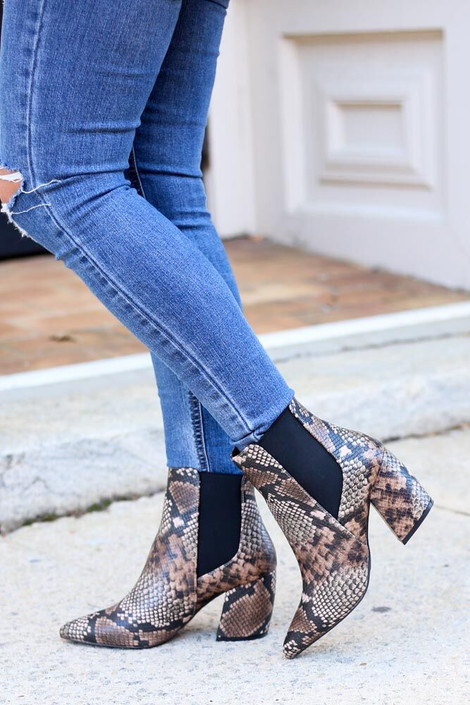 Model wearing the Brown Snakeskin Chelsea Booties from Dress Up