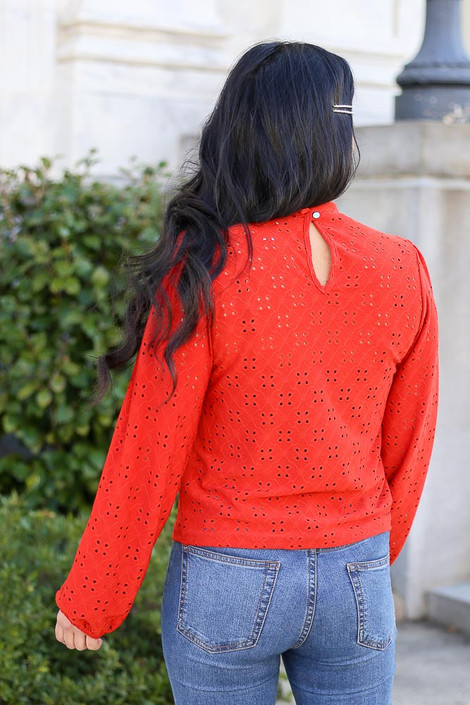 Model wearing the Mock Neck Eyelet Blouse with High Rise Jeans Back View