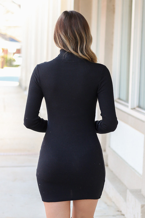 Model wearing the Ribbed Bodycon Dress in Black Back View