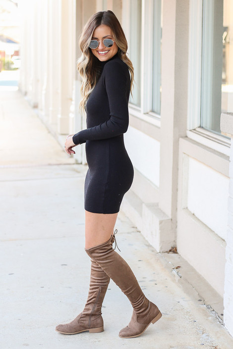 Model wearing the Ribbed Bodycon Dress in Black with over the knee boots