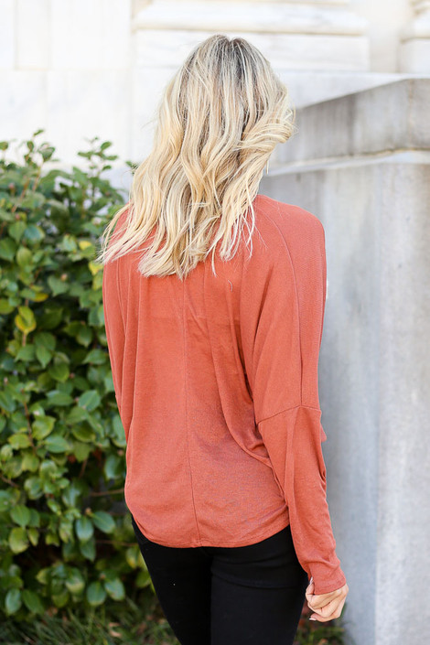 Model from Dress Up wearing the Drop Sleeve Surplice Top in Rust with Black Skinny Jeans Back View