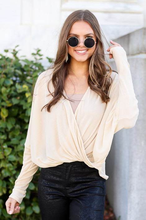 Model from Dress Up wearing the Drop Sleeve Surplice Top with sunglasses Front View