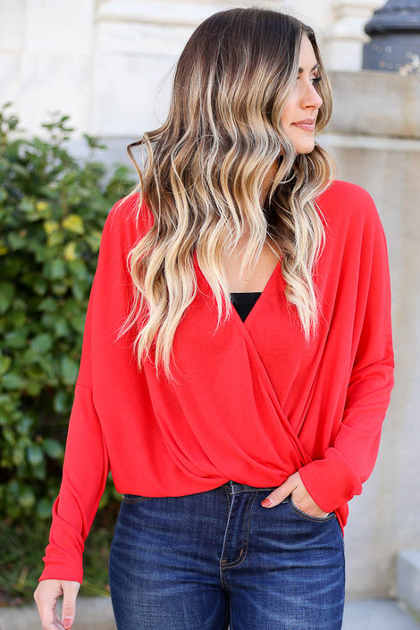 Model from Dress Up wearing the Drop Sleeve Surplice Top in Red with high rise jeans