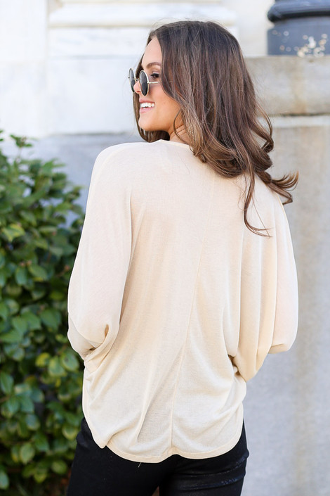Model from Dress Up wearing the Drop Sleeve Surplice Top in Taupe Back View in front of bush