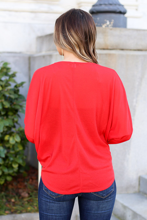 Model from Dress Up wearing the Drop Sleeve Surplice Top in Red Back View