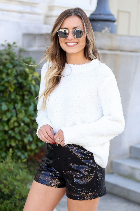 Model wearing Black Mid Rise Sequin Shorts with Ivory Knit Sweater from Dress Up Side View