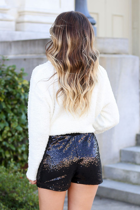 Model wearing Black Mid Rise Sequin Shorts with Ivory Knit Sweater from Dress Up Back View