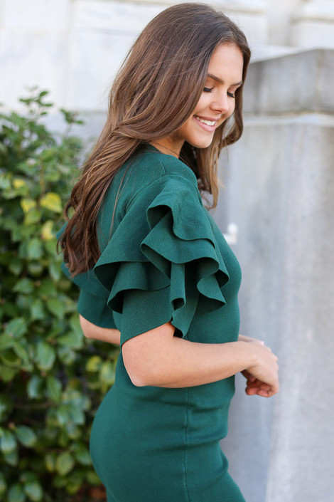 Model from Dress Up wearing the Ruffle Sleeve Holiday Dress in Olive Side View