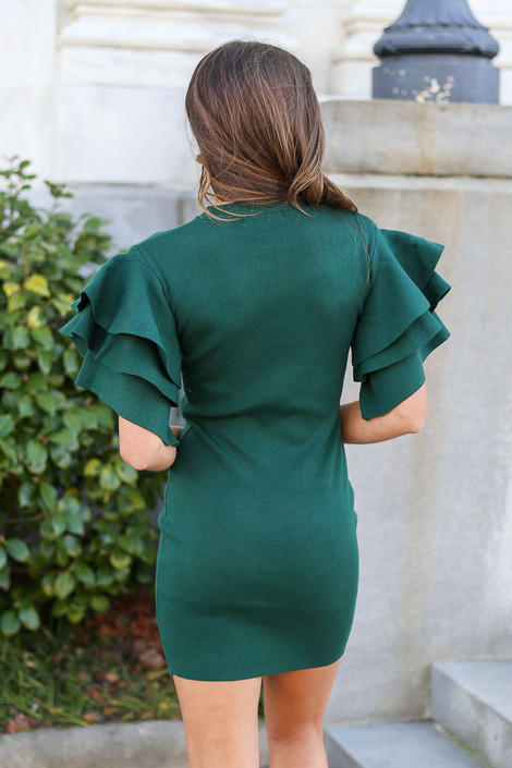 Model from Dress Up wearing the Ruffle Sleeve Sweater Dress in Olive Back View