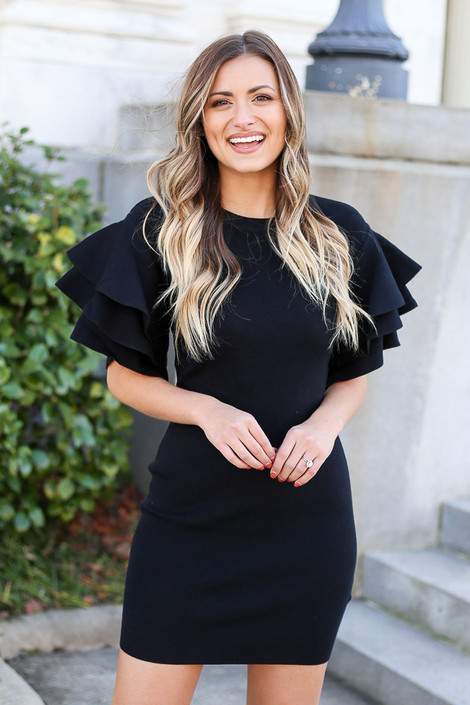 Model from Dress Up wearing the Ruffle Sleeve Sweater Dress in Black Front View