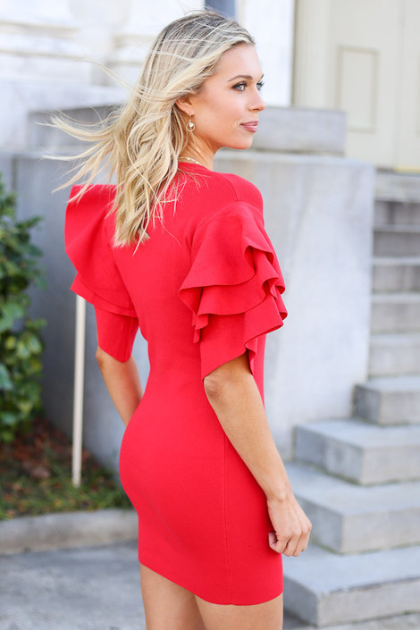Model from Dress Up wearing the Ruffle Sleeve Holiday Dress in Red Side View
