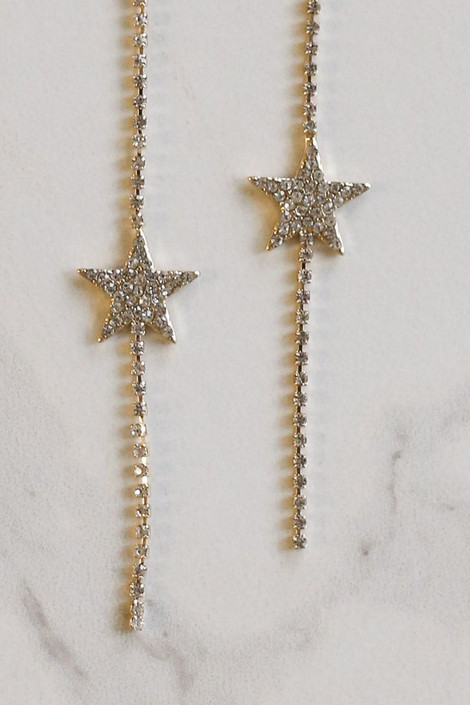 Flat Lay of Gold Rhinestone Star Drop Earrings from Dress Up