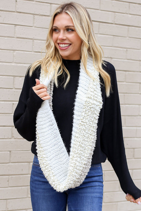 Model wearing thePopcorn Knit Infinity Scarf from Dress Up