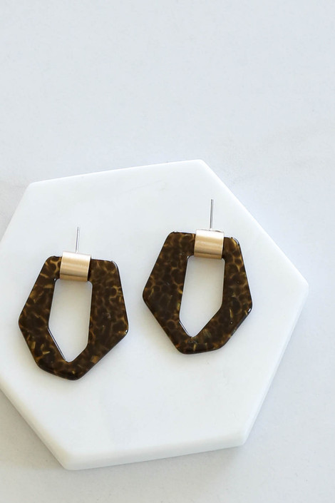 Geometric Statement Earrings Flay Lay on Marble from Dress Up