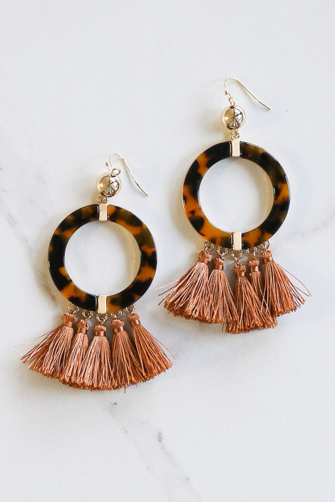 Flat Lay of the Tortoise and Tassel Statement Earrings  from Dress Up
