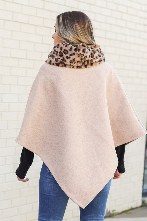 Model wearing the Leopard Print Faux Fur Turtleneck Poncho in Ivory from Dress Up Back View