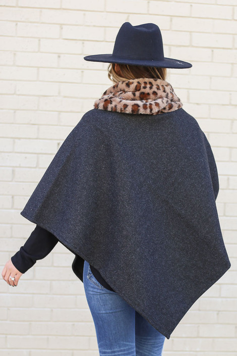 Dress Up Model wearing the Leopard Faux Fur Turtleneck Poncho in Black with black fedora hat