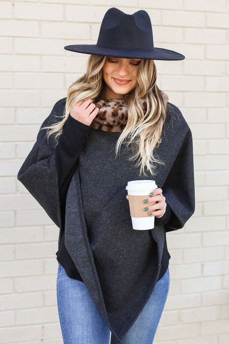 Model wearing the Leopard Faux Fur Turtleneck Poncho from Dress Up with medium wash jeans
