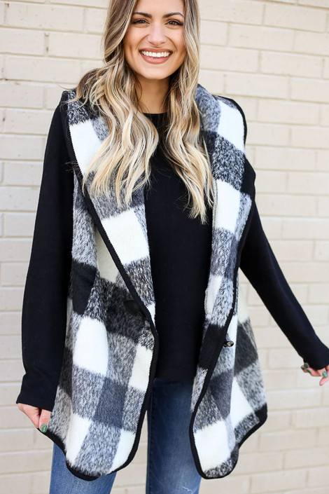 Model of Dress Up wearing the Buffalo Plaid Vest in Black with black sweater