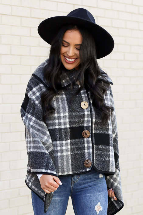 Dress Up model wearing the Plaid Oversized Collar Poncho with distressed denim Front View