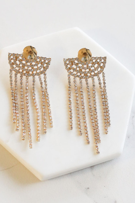 Flat lay of the Rhinestone Fan Statement Earrings from Dress Up