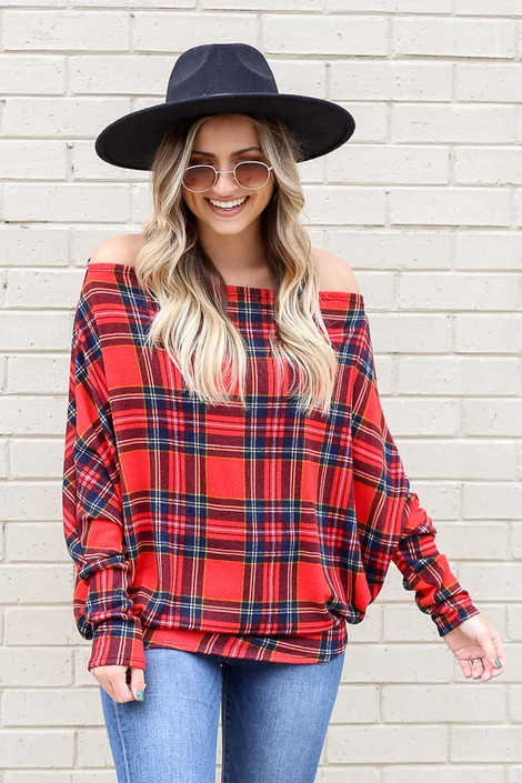 Model wearing Plaid Oversized Off the Shoulder Tunic with wide brim hat and light wash jeans