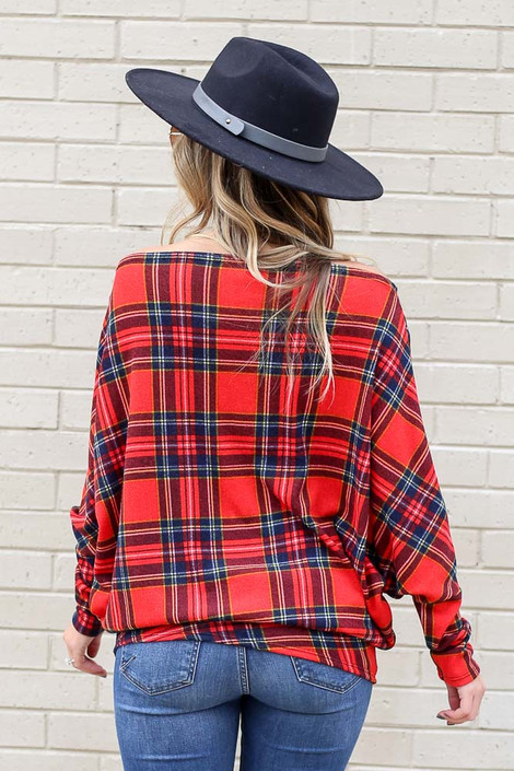 Model wearing Plaid Oversized Off the Shoulder Tunic with wide brim hat and light wash jeans Back View