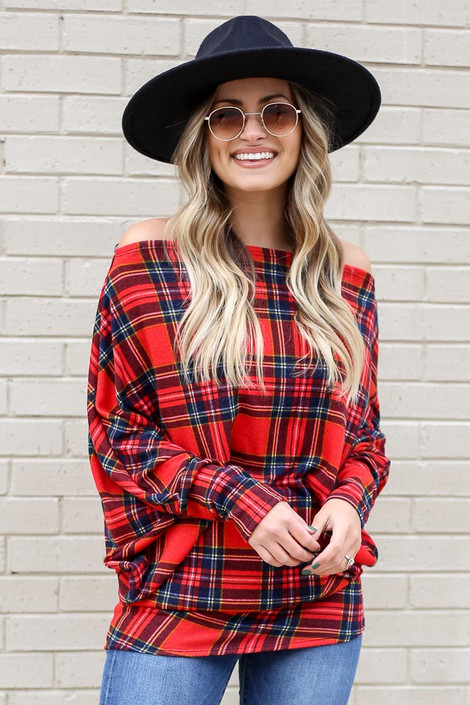 Model wearing Plaid Oversized Off the Shoulder Tunic with wide brim hat and light wash jeans Front View