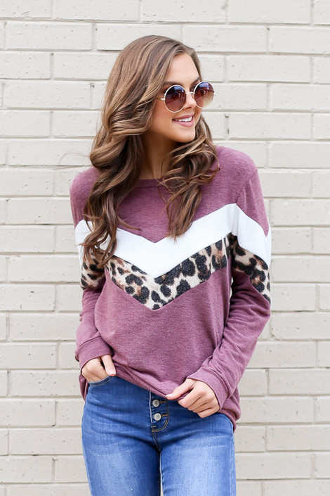 Model wearing the Chevron French Terry Pullover with skinny jeans