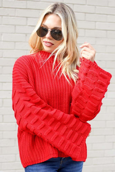 Model wearing the Textured Knit Wide Sleeve Sweater in Red from Dress Up Front View