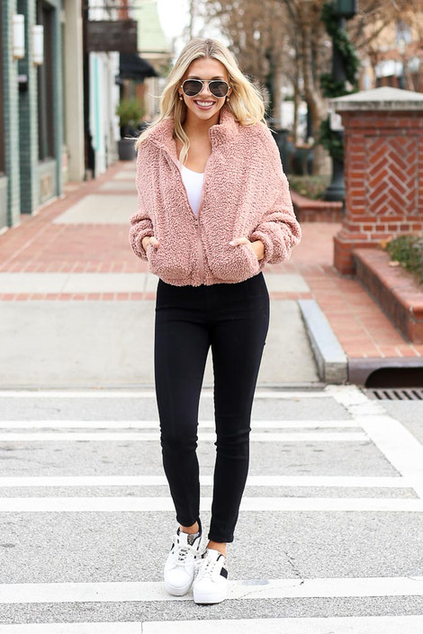 Model walking while wearing the Cropped Zip Up Sherpa Teddy Jacket