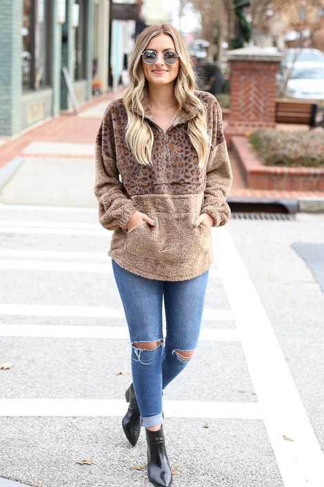 Model wearing the Leopard Fuzzy Knit Quarter Zip Pullover