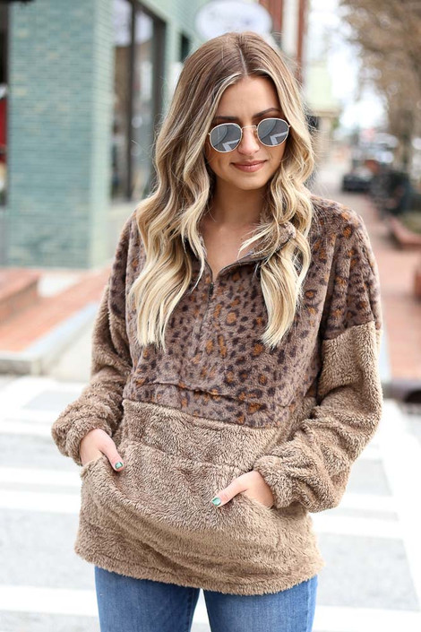 Model wearing the Leopard Fuzzy Knit Quarter Zip Pullover from Dress Up