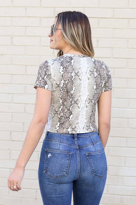 Model from Dress Up wearing Snakeskin Crop Top with jeans Back View