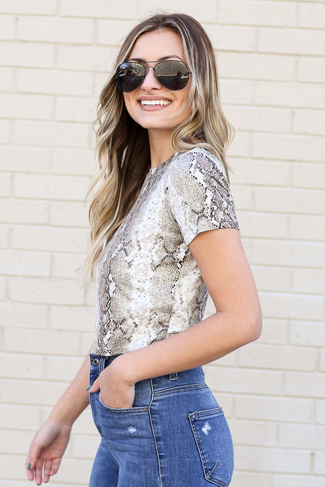 Model from Dress Up wearing Snakeskin Crop Top with jeans Side View