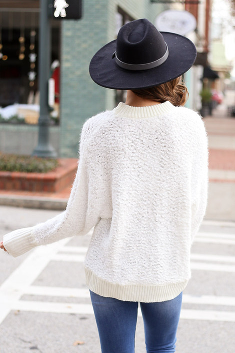 Model wearing the White Oversized Popcorn Eyelash Knit Sweater from Dress Up Back View