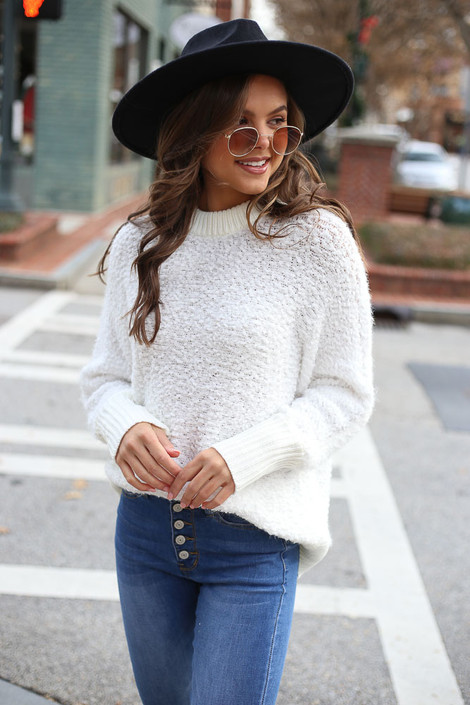 Model of Dress Up Boutique wearing the White Oversized Popcorn Eyelash Knit Sweater Front View